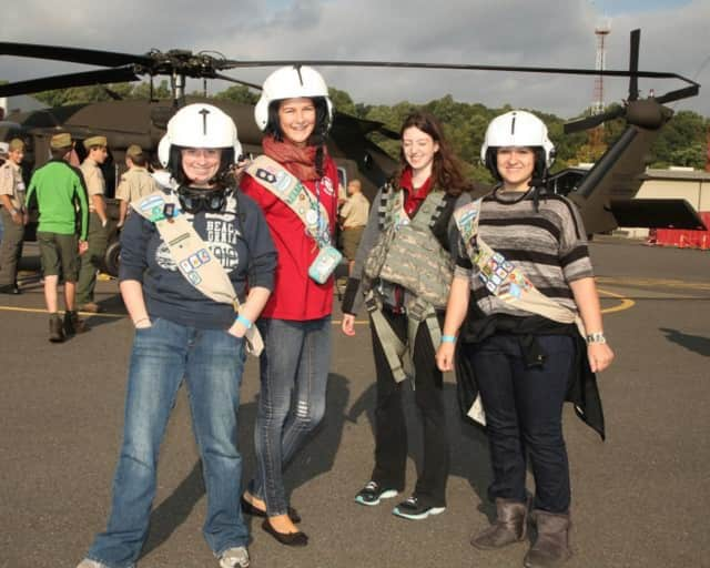 Girl Scouts get up close to helicopters during a weekend campout at Sikorsky Aircraft in Stratford.