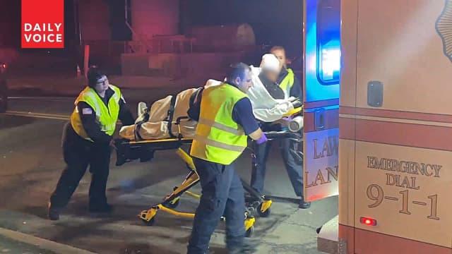 Fair Lawn Volunteer Ambulance Corps loads victim into ambulance following River Road road rage assault.
