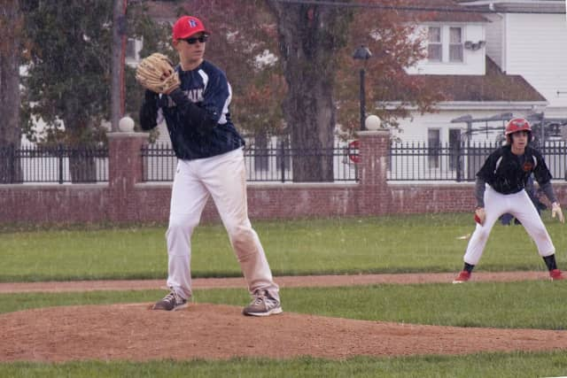 Snow is flying along with a fast ball at a Babe Ruth game in Ridgefield on Sunday.
