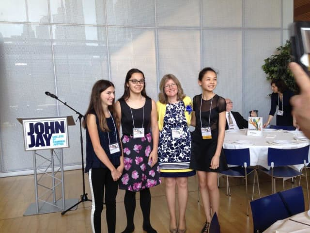 Eastchester Middle School students Alexa Cantrava, Sophia Sabelja and Sakura Abdel-Rahman received awards from AATSP.