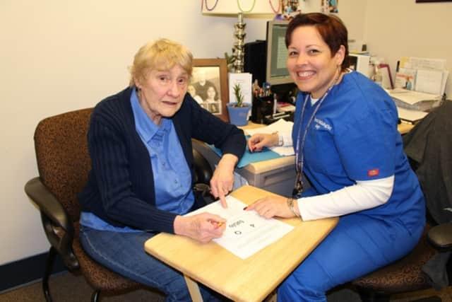 Stroke victim Lorna Armbruster and Jenny Kalanz, a speech-language pathologist at Putnam Hospital Center.