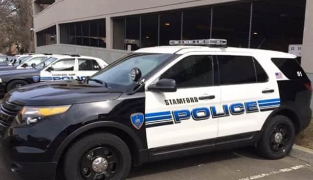 Two Stamford Police officers saved a woman suffering from a heart attack.
