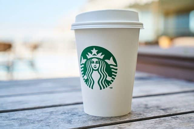 Starbucks will soon require customers to wear masks inside its stores in an effort to reduce the spread of COVID-19.