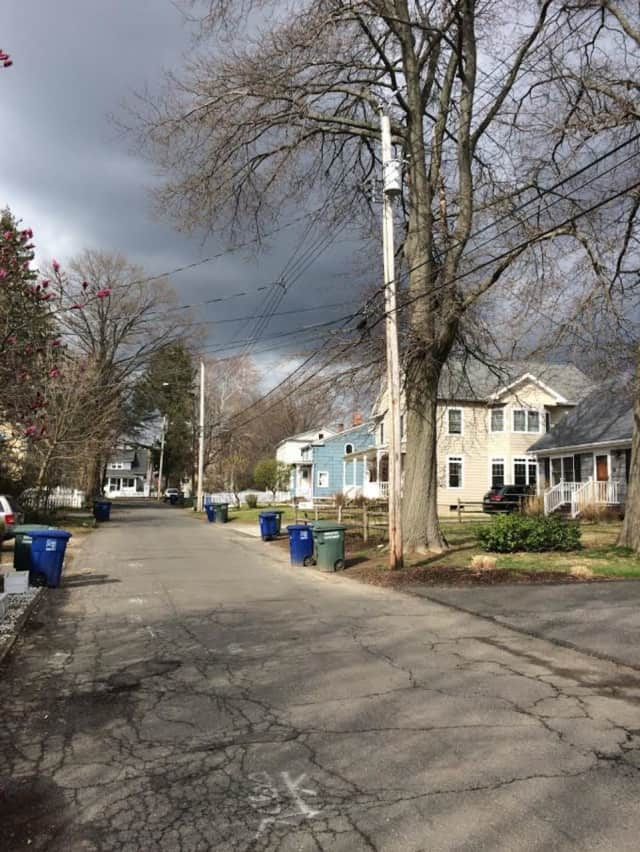 Dark storm clouds loom over Bridgeport on Friday morning. Rain — and snow — are in the forecast for the area.