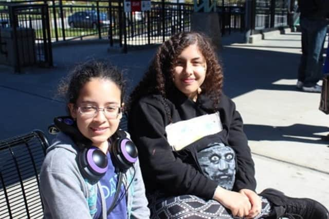 """Two students from the Summit Academy in Peekskill relax in Bryant Park recently before attending the Broadway play, """"Eclipsed."""""""