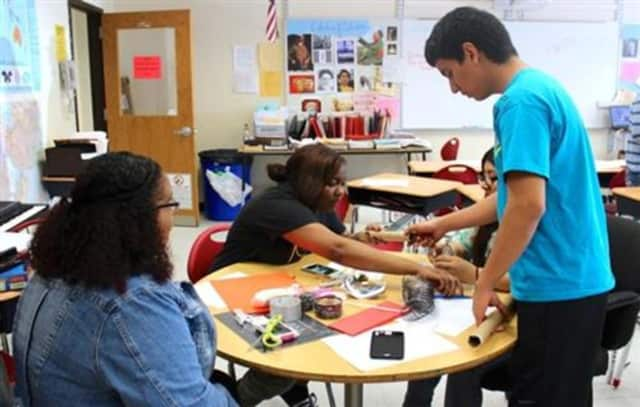 Students work together on a class project at Summit Academy in Peekskill.