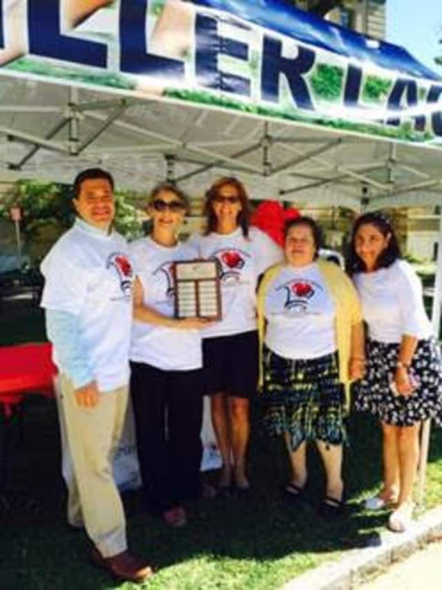 Shopper of the Year award winner Chris Bisceglia of Port Chester, N.Y., with SFS Program Director Elyse Brown, JFS of Greenwich Executive Director Lisa-Loraine Smith, and SFS shoppers Maria Roman and Odette Mouakad, in front of the Senior Center.