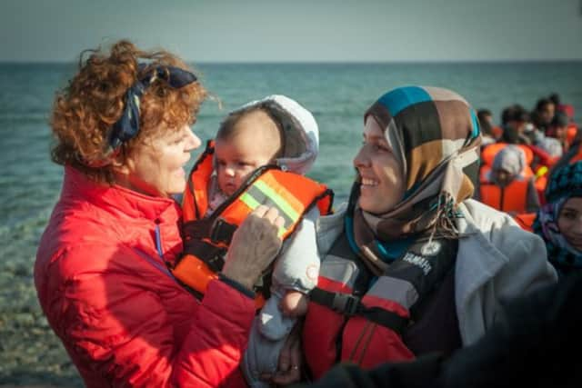 Actress Susan Sarandon, a former Pound Ridge resident, holds a tiny baby as she talks to Syrian refugees on the Greek island of Lesbos.