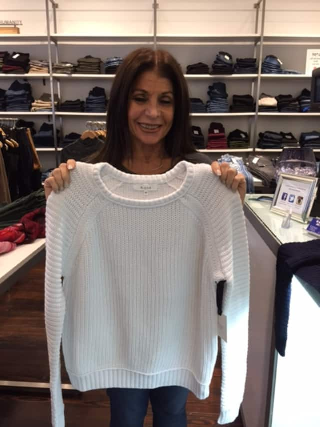 Sheryl Blit shows off one of the great sweaters in her store, Havana Jeans