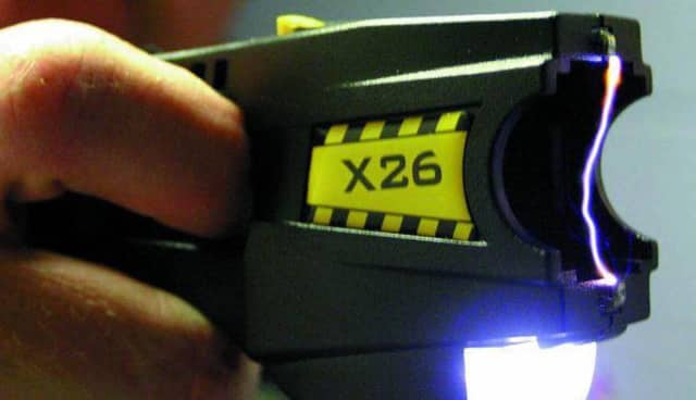 Two men were arrested at a Newtown carnival for displaying a Taser during a verbal fight.