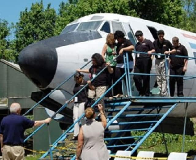 The ceremony will be held in the museum's parking lot at Teterboro Airport, 400 Fred Wehran Drive, located next to the FAA tower -- and will be moved indoors if it rains.