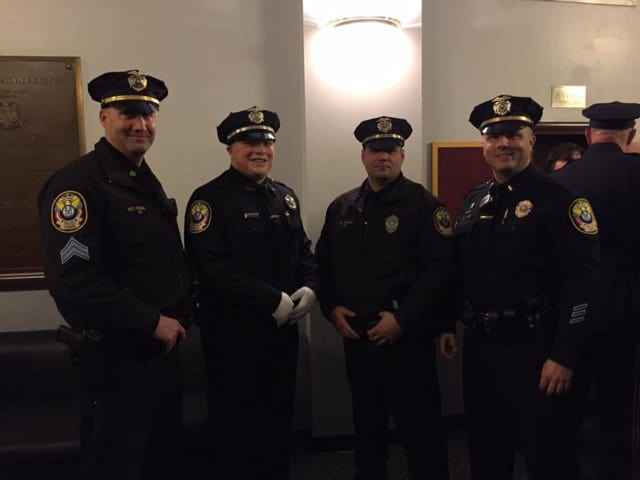 Ryan Tharas, second from left, joined the Bethel Police Department after training at the Connecticut Police Academy for the past six months.