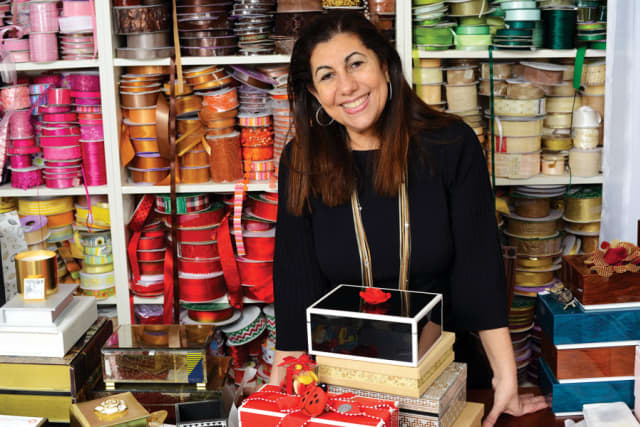 Lina Abdo – physician turned gift designer – at her home in Stamford, where the magic happens.