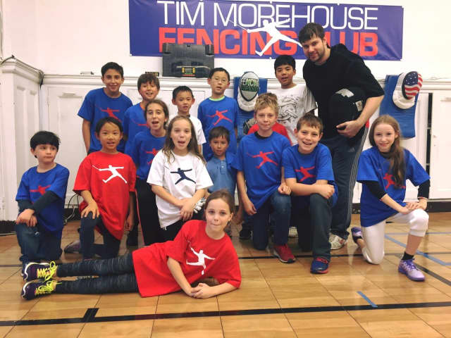 Tim Morehouse with his students at the Tim Morehouse Fencing Club.