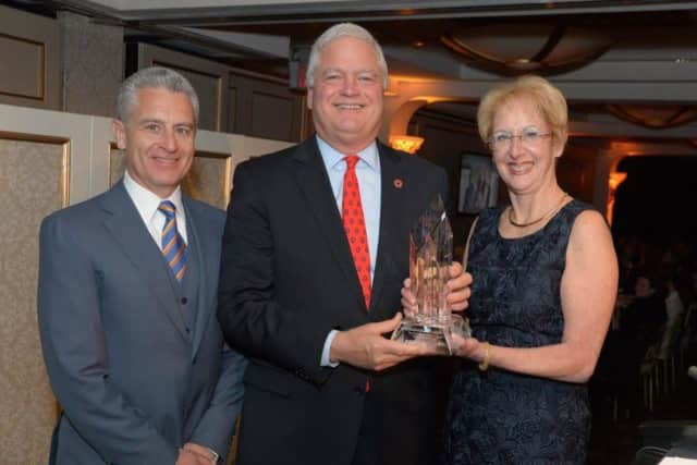 John Tolomer, Bank President & CEO (center) accepts the award from the Business Council of Westchester's Anthony Justic and Marsha Gordon.