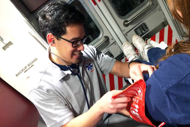 North Salem Volunteer Ambulance Corps member Tomo Monte shown measuring blood pressure.
