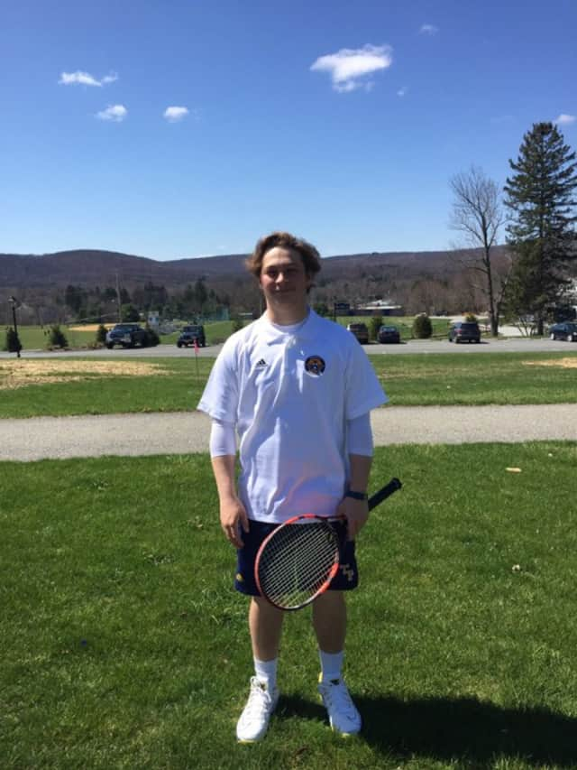 Trinity Pawling School tennis player Justin Lampert shows off the school's new tennis gear. Trinity will play Canterbury at home April 16.