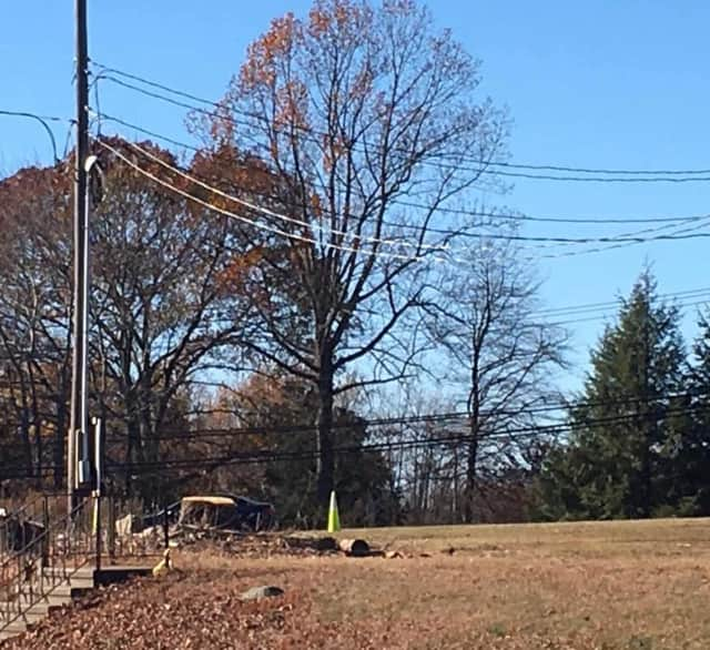 Roadwork in Monroe at the Routes 110-111 intersection necessitated the cutting of trees.