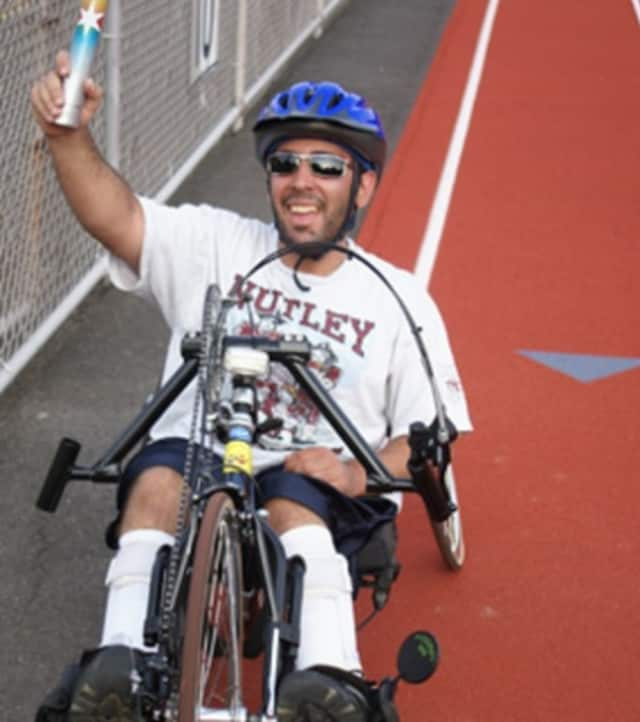 An athlete laps the track at the Tri-State Wheelchair & Ambulatory Games in Hillsdale.