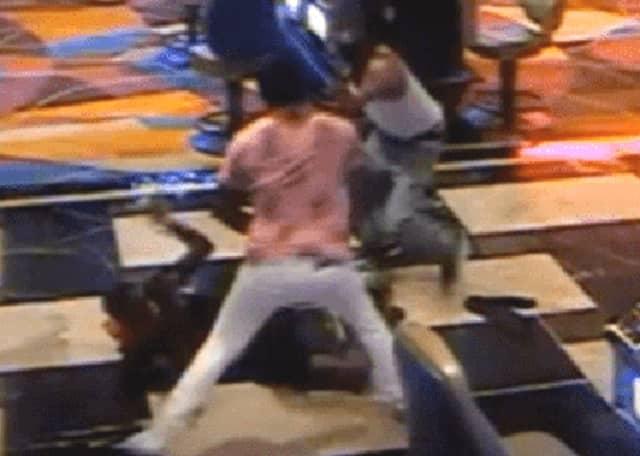 Surveillance image from brawl on Atlantic City Tropicana Casino floor.