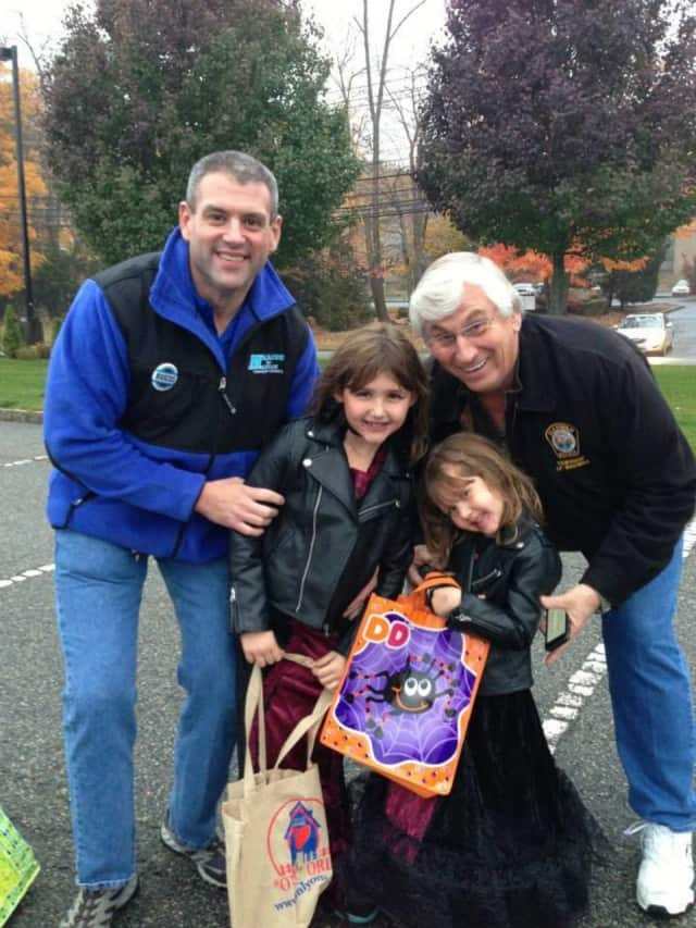 Jonathan Marcus and his girls pose with Mayor Bill Laforet during Mahwah's 2013 Trunk or Treat.
