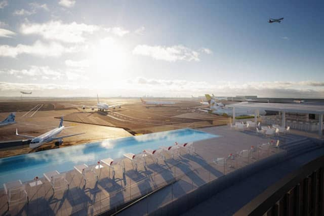 JFK's new infinity pool and observation deck at the TWA Hotel overlooks one of the airport's largest runways with views to Jamaica Bay.