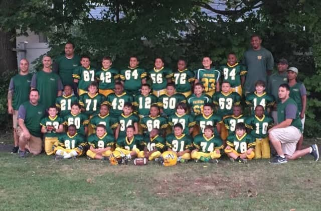 The Norwalk Packers 8-and-under youth football team finished the season with an 8-0-1 record.