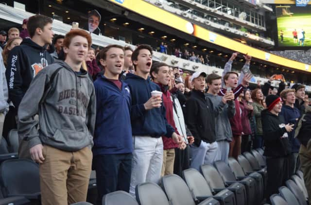 Ridgewood fans cheer on the football team during the state finals game against Passaic Tech at MetLife Stadium last year.