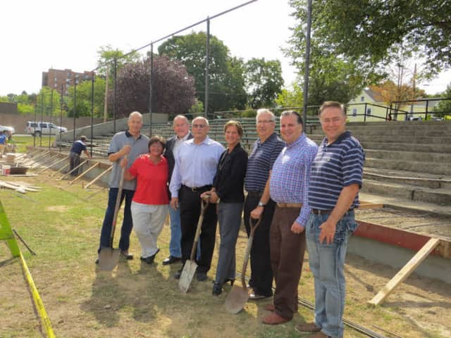 Eastchester Parks General Foreman Pat Anetta, Council members Theresa Nicholson, Joe Dooley, Glenn Bellitto, Luigi Marcoccia, Supervisor Anthony Colavita and Legislator Sheila Marcotte breaking ground at Parkway Oval Field.