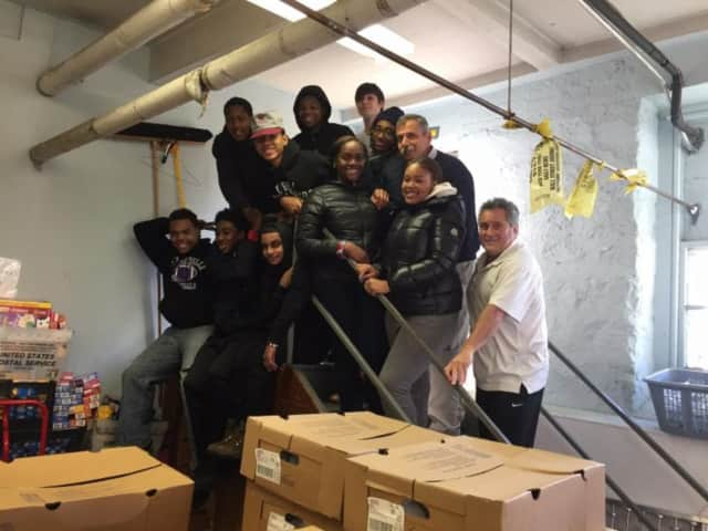 Campus Alternative high school students and faculty kicked off the holiday season by bringing food to needy families in New Rochelle.