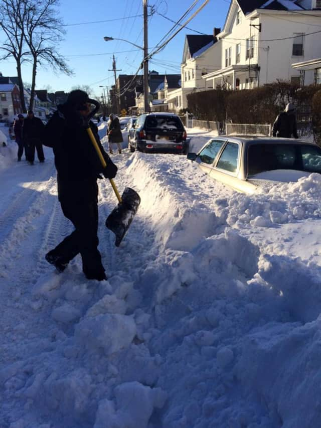 Mount Vernon Mayor Richard Thomas shoveled snow on Monday.