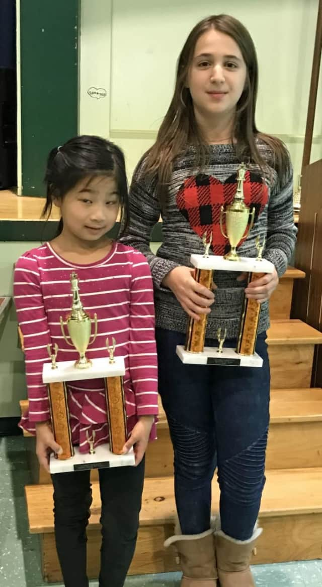 Scarlett Chen from Seely Place School in Scarsdale and Sophie Surguladze from Main Street School in Irvington display their trophies won in a recent chess tournament. The next tournament is Saturday in New Rochelle.