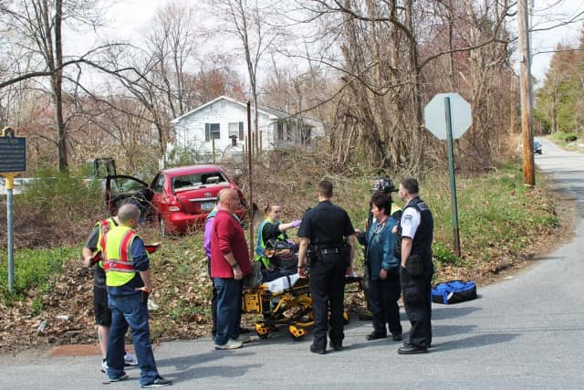 Emergency crews remove the injured driver.
