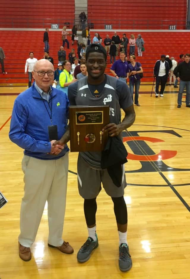 A.J. English accepting his MVP award at the Portsmouth Invitational Tournament Championship.