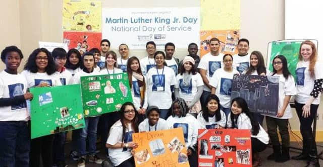 A group of volunteers celebrating after volunteering during the 2015 Martin Luther King Jr. National Day of Service.