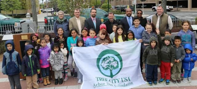 Deputy Mayor Jared Rice and city officials marked Arbor Day with a tree planting at Ruby Dee Park at Library Green, assisted by children participating in the New Rochelle Public Library's Family Arbor Day celebration.