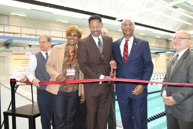 Mount Vernon Schools Superintendent Kenneth Hamilton cutting the ribbon to the new pool with Assemblyman J. Gary Pretlow.