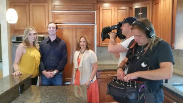 "Grace Patalano, center, filming an episode of HGTV's ""House Hunters."""