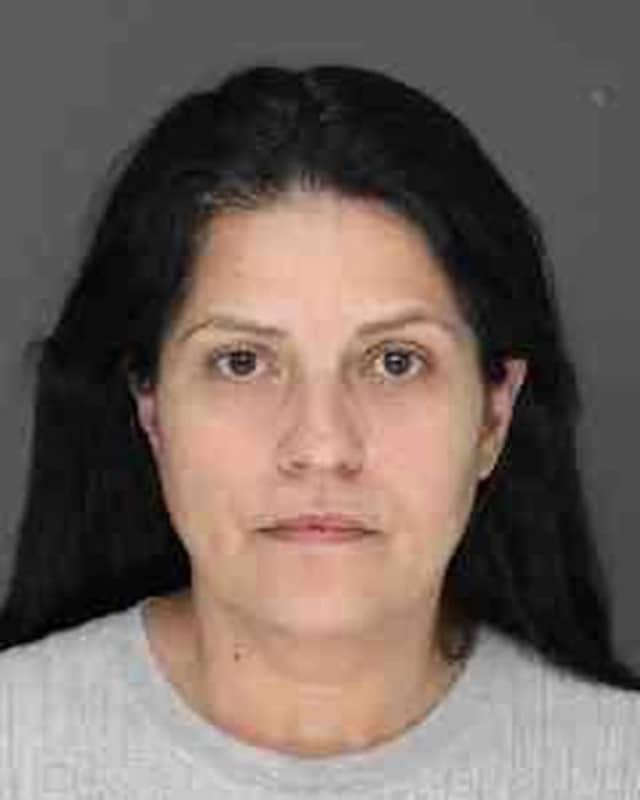 Maria Ruiz, 51, was charged with attempting to cash a fraudulent check at the Chase Bank in Spring Cottage.