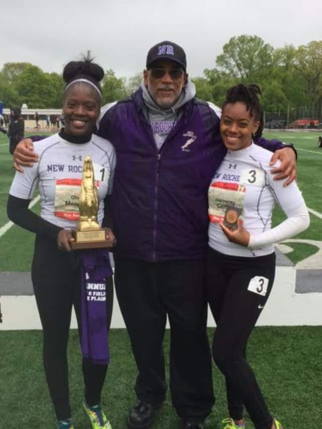 Olivia Morgan (left) and Jeanneney Currie (right) pose with their coach, Andy Capellan (center).