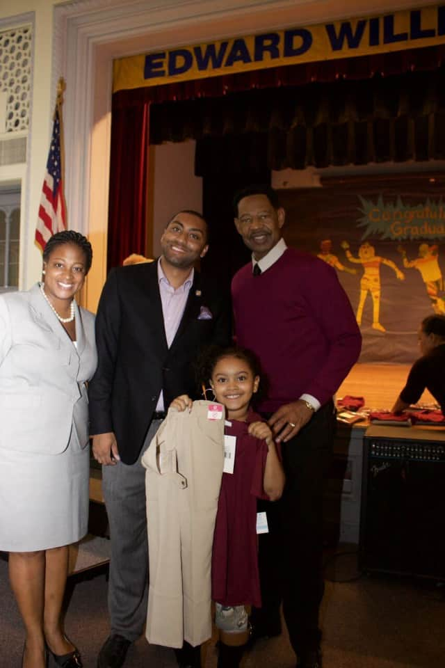 Edward Williams Principal Crystal Waterman, State Sen. Jamaal Bailey, Superintendent Dr. Kenneth R. Hamilton and happy student show off the new uniforms that Sen. Bailey presented to the school during his recent visit.