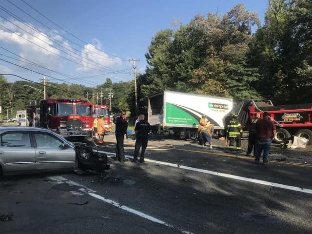 Route 303 is closed in both directions following a three-car crash.