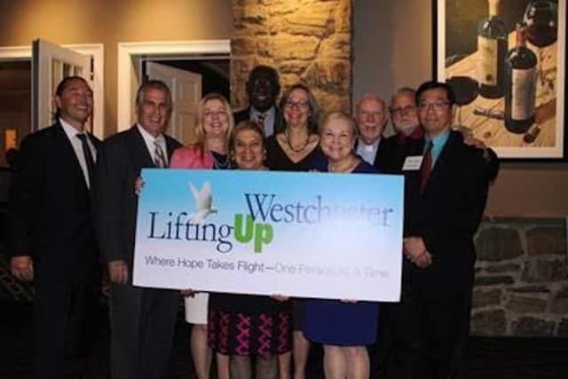 Members celebrate the fundraising efforts of Lifting Up Westchester.