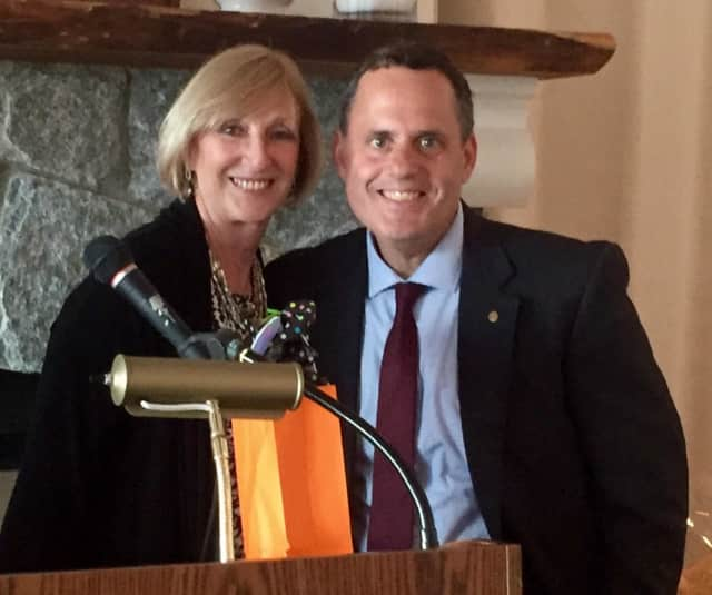 Immediate past president of the Rye Rotary Club Pamela Dwyer with new president Jason L. Mehler.