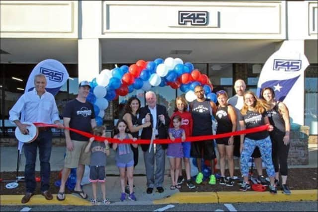 Fairfield First Selectman Mike Tetreau cuts the ribbon at the grand opening celebration at F45 Fairfield USA. See story for IDs.
