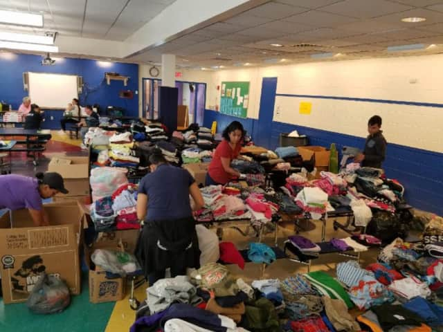 Volunteers in New Rochelle organizing the donations that will be shipped to Mexico City and Puerto Rico.