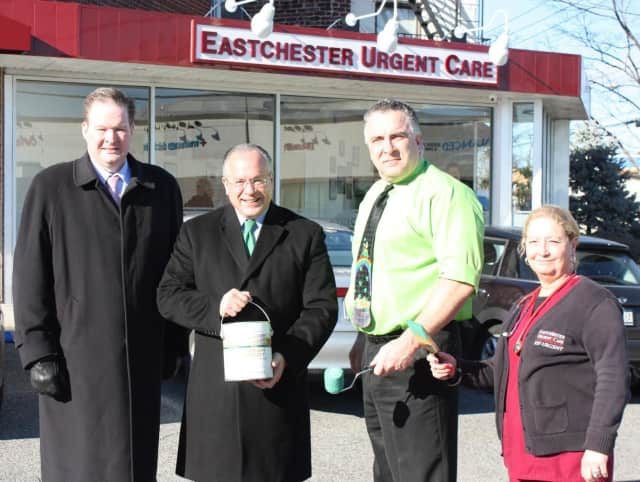 Green Line sponsor Brendan Lynch, Eastchester Town Supervisor Anthony Colavita, Dr. Mack Sullivan and Laurie Trangucci painted the route of the annual St. Patrick's Day Parade.