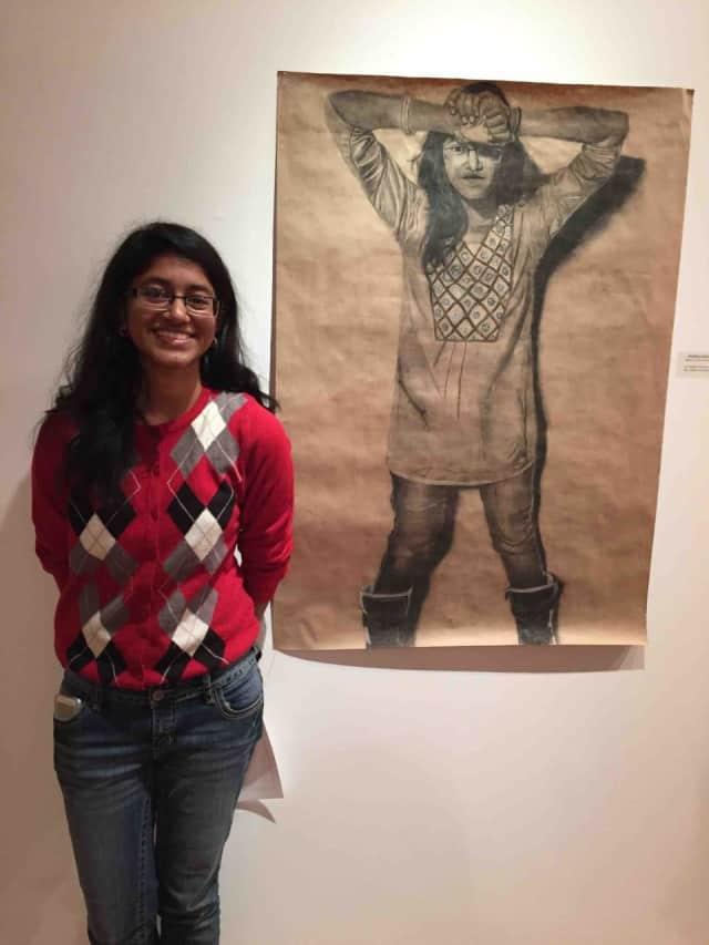 "Bronxville High School senior Indira Dasgupta won the prestigious Concordia College Osilas Gallery stArt Regional High School Exhibition Award of Excellence. She was presented with the award for her self-portrait, ""Self-Portrait Wearing a Kurta."""