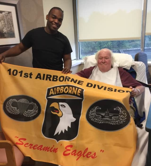 Army Pfc. Kevin Irving has made it a habit to come visit veterans in New Rochelle. He recently presented his friend John with a flag from his 101st Airborne Division.