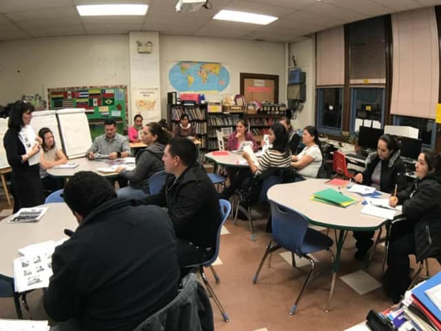 Isaac E. Young Middle School has begun offering free ESL classes for adults.